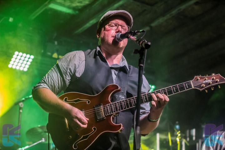 Carl playing guitar and singing